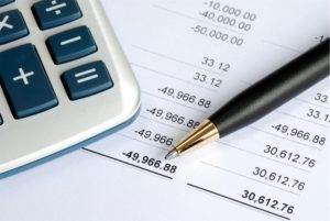 Bank records forming part of a SME working capital loan application, along with a pen and calculator