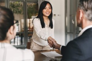 woman-shaking-hands-with-business-partner