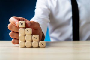 hand-building-wooden-cubes-with-upwards-arro