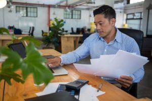 business executive using laptop at desk