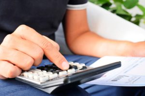 Man calculating his business finances, hoping to get a higher credit limit