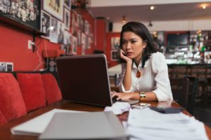 Young business owner browsing business line of credit payment structures