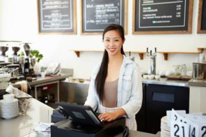 Smiling business owner thinking of taking a business line of credit