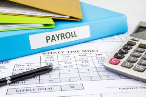 A Payroll business loan file with weekly timesheet and calculator