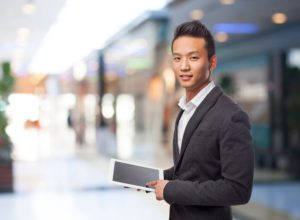 Business owner holding a tablet device