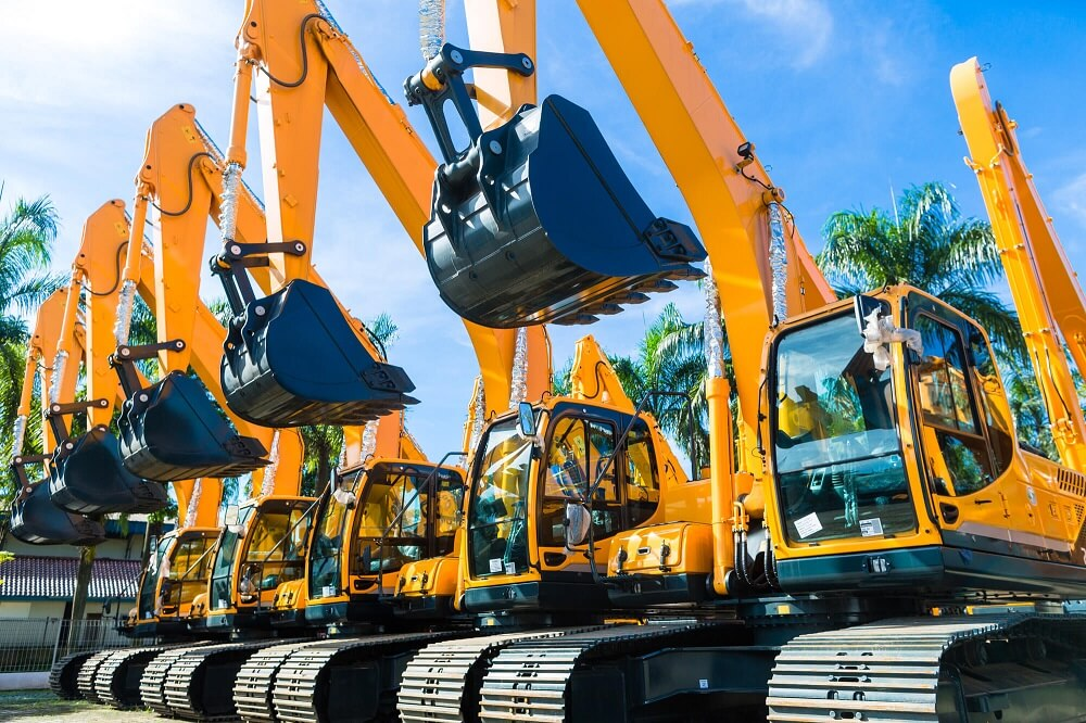 Image of 5 shovel excavators, one of the heavy machinery ideal for a hire purchase agreement