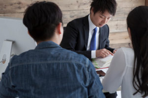 Financial advisor helping two business owners with their hire purchase plan