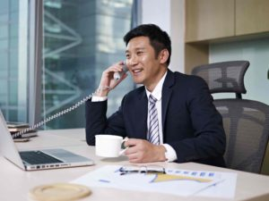A businessman calling a financial institution to enquire about a temporary bridging loan
