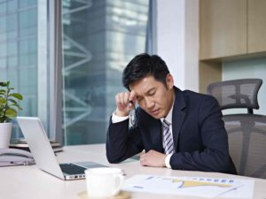 A businessman stressed because his Temporary Bridging Loan Programme application was rejected