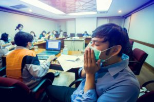 Employees wearing masks in a conference room