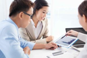 A financial advisor from a PFI guiding business ow